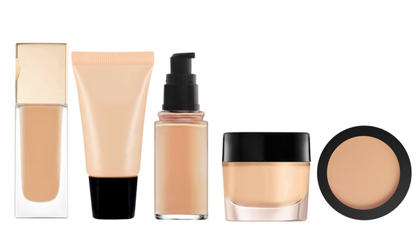 liquid makeup foundation in bottle and face powder isolated on w