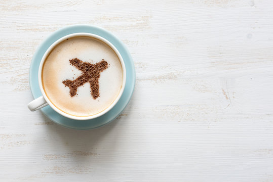 Airplane made of cinnamon in coffee. Cup of Cuppuccino. Travel concept