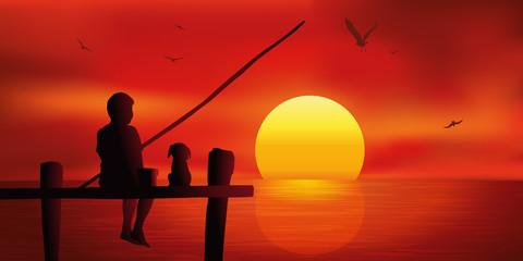 Enfant pêche - chiot - coucher de soleil