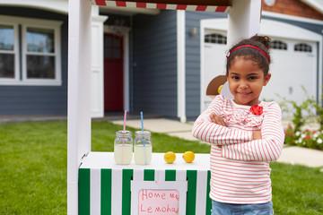 Portrait Of Girl Running Homemade Lemonade Stand