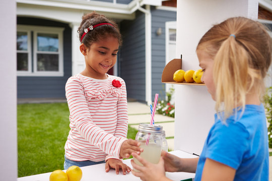 Two Girls Running Homemade Lemonade Stand