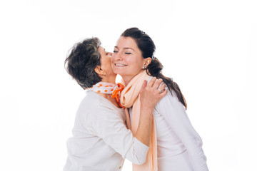 Senior woman giving a kiss to smiling female