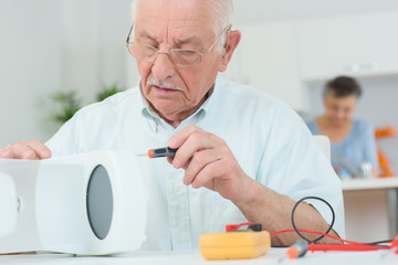 elderly man with a coffee maker