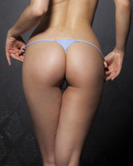 beautiful attractive female body in erotic blue thong
