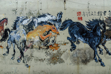 graffiti of horses in a wall of the city of Melaca in Malaysia