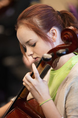 Caucasian student musician playing cello