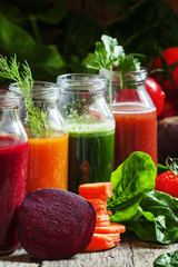 Four kind of vegetable juices: red, burgundy, orange, green, in