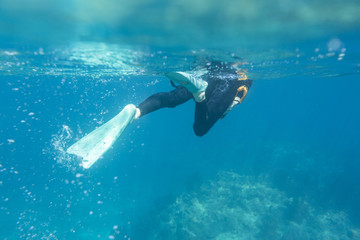 Caucasian woman snorkeling in tropical ocean