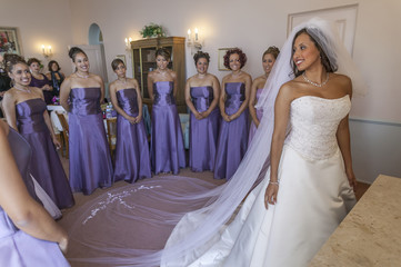 Bride and bridesmaids smiling before wedding