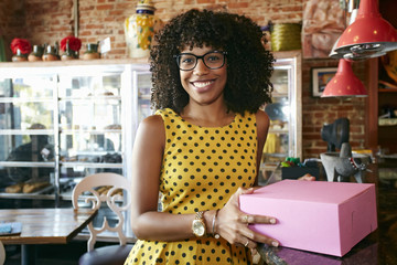 Mixed race woman buying pastries in bakery