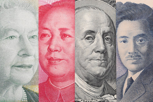 Currency War. Photo Shows Canadian, Chinese, US and Japanese Banknotes