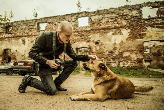Caucasian photographer petting dog