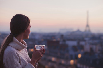 travel to Paris, woman looking at Eiffel tower and beautiful panorama of the city