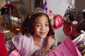 Girls wearing tiaras at party