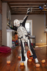 Black boy wearing skeleton Halloween costume
