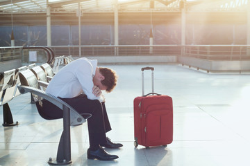 problem with transportation, delay of flight, depressed commuter with his luggage