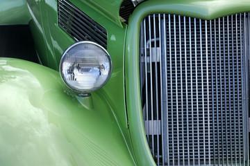 Closeup of classic green roaster car