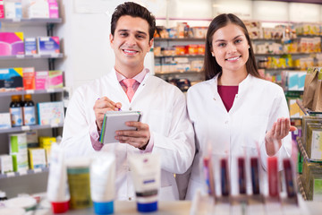 Young team in chemist shop