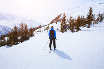 skiing in Alps, winter sport in mountains, skier and beautiful landscape