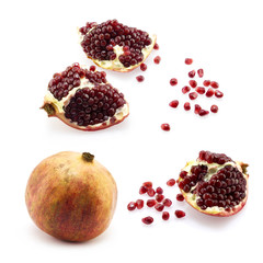 Set of pomegranate with grains on white background
