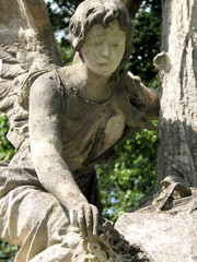 ancient stone sculpture girl-angel with wings mourn for the dead