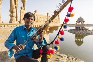 Man holding traditional instrument, Rajasthan, India
