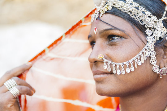 Close up of Indian woman wearing traditional jewelry