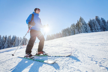ski in Alps, winter sport, young skier on the slope in sunny day