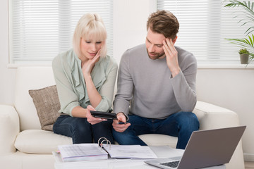 Unhappy Couple Calculating Bills