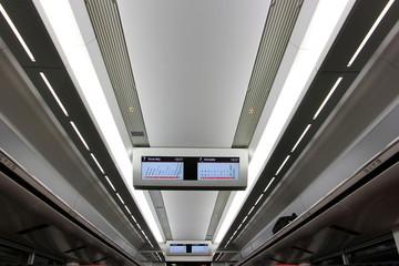 Digital schedule board on ceiling in Narita express train