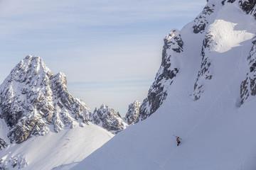 Man climbing a snowcapped mountain