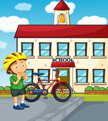 School scene with boy and bike