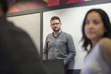 Businessman standing in office meeting