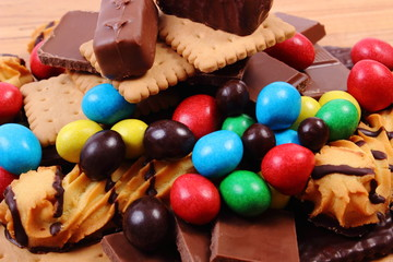 Autocollant pour porte Confiserie A lot of sweets on wooden surface, unhealthy food