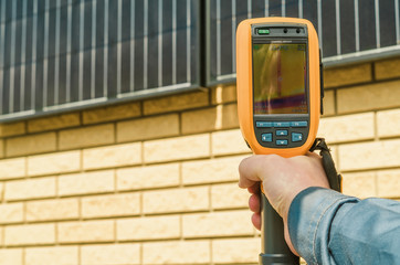 Thermal imaging of Photovoltaic Solar Panels on the Wall With Th