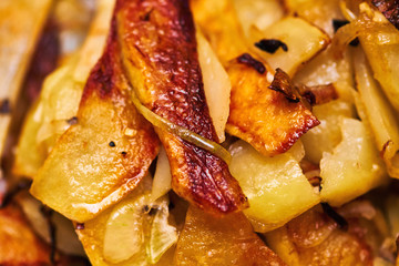 Fried potatoes on the pan