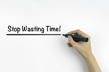 Hand with marker writing: Stop Wasting Time!