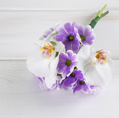 Bouquet of primroses and  orchid