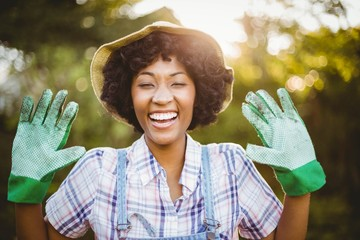 happy woman showing her gardening gloves