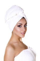 Beautiful young ethnic woman in white towel