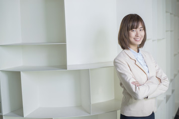 Attractive asian business woman smiling in workplace
