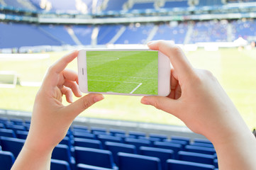 man takes a picture the football stadium