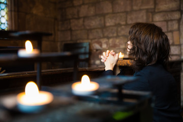 Young Man Praying and Meditating in a Church
