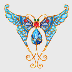 Gold butterfly with blue wings and precious stones
