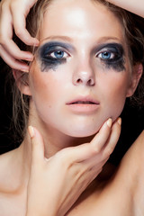 Beauty portrait of woman with black messed make up