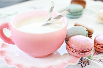 Pink Macarons and Milk with shallow depth of field.