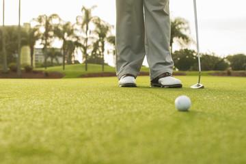 Caucasian man standing on golf course green