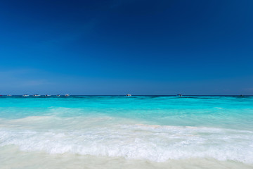 Wall Mural - Water clear at the sandy beach with blue sky