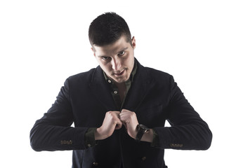 portrait of a young businessman looking serious with his hands on his chest