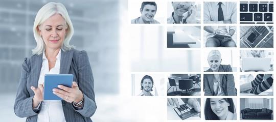 Composite image of confident businesswoman using digital tablet